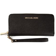 Black leather 'Jet Set' continental wallet from Michael Michael Kors  featuring a top zip fastening, a gold-tone logo plaque, a wrist strap, ...