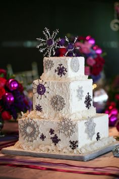 silver and plum snowflakes winter wedding cake