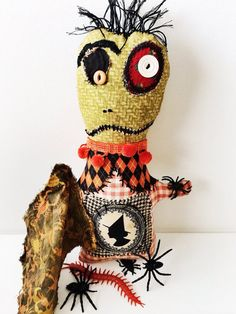Handmade Halloween Monster Doll Scorpion Spiders by Etsy store artist dollyzemomma; great use of print fabric for the head.