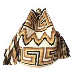 These double thread Wayuu mochila bags are all made in the region of La Guajira, Colombia by indigenous Wayuu women. Mochila bags are a very important handicraft that helps sustain the indigenous Wayuu people. These bags take approximately 10 days to make. The craft of crocheting is learnt at an early age and passed down from generation to generation. The mochilas are a reflection of the everyday shapes that surround the lives of the Wayuu tribe. Buy yours at www.lombiaandco.com Tapestry Bag, Tapestry Crochet, Girls Bags, Crochet Designs, Handicraft, Purses And Bags, Pouch, 10 Days, Shoulder Bag