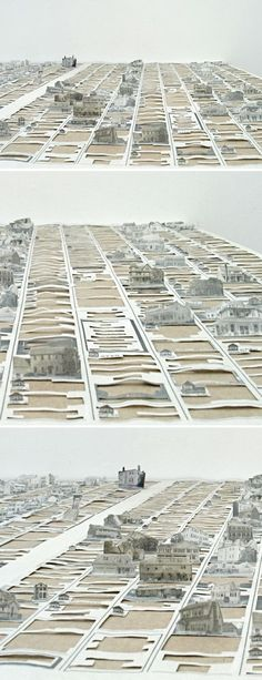 cut newspaper installation by pat shannon