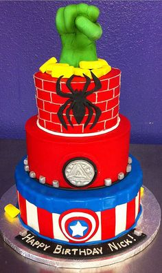 superhero cake. I love the hulk hand on top! fantastic idea.