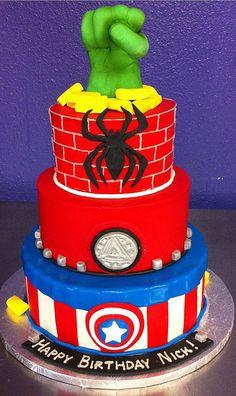 superhero cake. I love the hulk hand on top! fantastic idea.