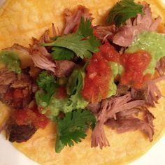 And dinner is served! Homemade carnitas tacos with avocado verde sauce made from scratch! Yum! Leftovers will make delicious burrito bowls, too. I added a little sumac spice to the seasoned salt brine for the pork and topped with garlic and shallots because I didn't have an onion on hand. Loved the way they turned out. #homemade #recipe on the #foodblog www.theweeklymenubook.com  #glutenfree #caseinfree #dairyfree