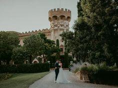 Bride and groom posing at dark academia castle wedding venue