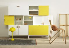 Tetris in yellow and white with leather handles.