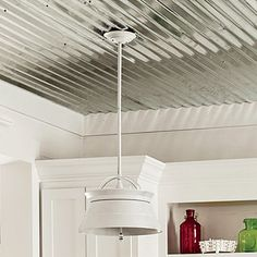 16. Metal Ceilings - Smart Cottage Style Home - Southern Living Typically used for barn roofing, this corrugated material adds authentic farmhouse charm for only about $15 per sheet.