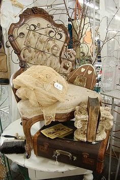 Flea Market...love the chair and old suitcase.