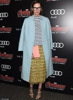 What a look: J. Crew president Jenna Lyons showed her style in a long seafoam green coat over a black and white striped tie, a frilly gold skirt and matching gold strappy heels