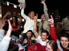 Boston Red Sox fans celebrate in the street near Fenway Park following Game 6 of the World Series