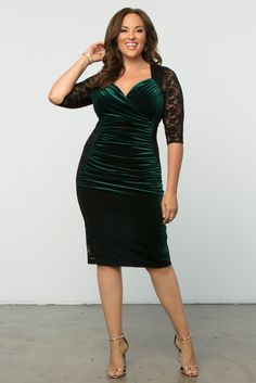 Our plus size Hourglass Lace Dress features a gorgeous green velvet panel against black lace. This bodycon option is ruched throughout for a flattering silhouette. Shop our entire collection online at www.kiyonna.com.