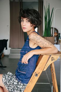 Not sure where to PIN. I love the tattoo, the hair, the fashion. Going on all 3 boards!: