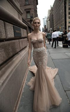 This deep champagne dress by Inbal Dror puts a unique twist on the classic wedding gown. Image: Ivory