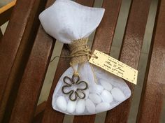 50 handmade wedding or bridal shower favors. Linen gauze with flower charm. Ships everywhere. by Heartofstardust on Etsy
