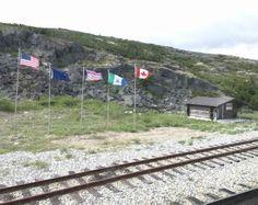 Skagway Train Trip NWMP Alaska BC Border with Flags