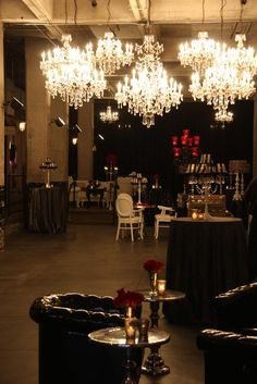 Corporate Party at Aria - chandelier lighting Grungy, eclectic decor for social hour with beautiful tables in gold hues for dinner
