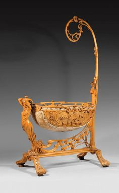 Berceau en bois art nouveau.  Art Nouveau French wooden cradle. Artist unknown.