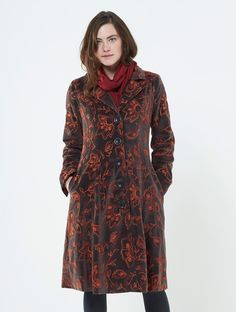 Our most coveted embroidered velvet coat this season. Navy blue and shark grey with beautiful colourful floral patterns, this plush cotton velvet dress coat has an elegant silhouette. Lined in smooth satin with side pockets and back belt detail. One to cherish.