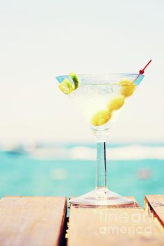 Tropical martini dream by Ekaterina Molchanova  Glass of martini bianco at the wooden pier. Concept of summer vacation. Popular cocktail by the sea. Vacation background. Vertical, toned