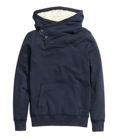Dark blue long-sleeve sweatshirt with warm lined hood, top buttons, and brushed inside. │ H&M Divided Guys