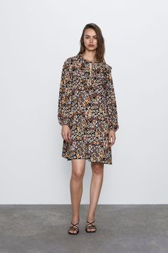 Dress featuring a slot collar with tied detail, long puff sleeves with elastic trim and matching ruffle trim. HEIGHT OF MODEL: 177 cm. Zara Outfit, Ruffle Trim, Ruffles, Zara Home Stores, Long Balloons, Mannequin, New Dress, High Neck Dress, Sleeves