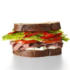 Bistro Beef Sandwich Recipe -Red pepper lends a nice crunch to this satisfying roast beef sandwich. If you like garlic, you'll love the zing added by the garlic-herb spread. —David Locke, Woburn, Massachusetts