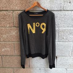 Number 9* Wildfox Sweater Great pre used condition. I only wore twice and washed once but was hung to air dry. Wildfox Sweaters Crew & Scoop Necks
