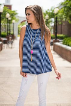 A Day In The Sun Tank, Navy    This precious tank will allow you to comfortably spend a day in the warm sun! The fabric is soft and the fit is incredibly comfy! That stretchy fabric won us over in a heart beat! Well that and those navy and white nautical stripes!