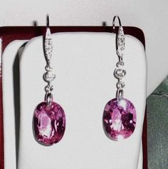 """30-cts-Natural-Oval-Pink-Sapphire-gemstones-silver-leverback-Pierced-Earrings 250 $ - 0 cts Natural Oval Pink Sapphire stones & SOLID Sterling Silver cz leverback Pierced Earrings The stones are absolutely genuine, with all bright sterling silver pinchers, connectors with a cz in each earring and also leverbacks with cz's. Measures approx. with earring leverbacks 2 inches Tall x 1/2 inch wide. Stones measure 5/8"""" T x 1/2"""" W. Earrings come in an earring box & outer white gift box."""