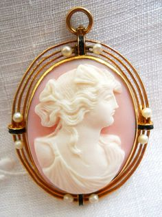 Antique Victorian Carved Pink Shell Cameo Pendant/Brooch Mounted In A 14k Gold Setting With Seed Pearls And Black Enamel   c. Mid 1800's