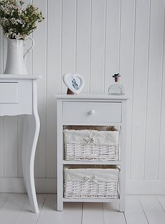 Three drawer white bedside table