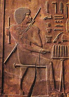 """Hesy-Re, relief on wood from his tomb in Saqqara. He was an official, physician (possibly the first known in history) and scribe who lived during the Third dynasty of Egypt, served under the pharaoh Djoser, and was buried in an elaborate tomb at Saqqara. He bore titles such as """"Chief of Dentists and Physicians"""" and """"Chief of the King's Scribes""""."""