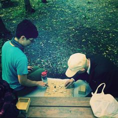 playing board game in a park.