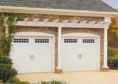 Carriage style garage doors with pergola