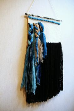 Woven wall hanging Boho touch for your sweet home or work studio! Size: 11 x 23 / 28 x 58 cm Width of dowel: 16 / 31 cm Features wooden hand-painted dowel, wool yarn & hand cut design. WORLDWIDE shipping - READY to ship! MORE wall hangings in my shop: https://www.etsy.com/shop/Delekselja?section_id=16545504&ref=shopsection_leftnav_3