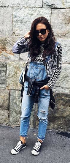 A Patterned Shirt, Overalls, a Knotted Leather Jacket, and Black Sneakers