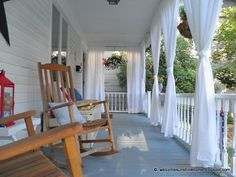 plain white twin sheets make pretty porch curtains