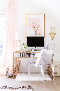 Create an upscale and elegant office space with a mirror-top desk and framed artwork.