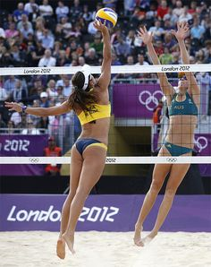 Brazil's Maria Antonelli, left, spikes against Australia's Louise Bawden during a beach volleyball match at the 2012 Summer Olympics.