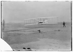 "Johnson proclaimed December 17 ""Wright Brothers Day"" to commemorate the first heavier-than-air powered, controlled flights. In this picture Orville Wright is at the controls and his brother Wilbur is running alongside. National Aviation Day, Wright Flyer, Neuer Job, Wright Brothers, Kitty Hawk, Today In History, December 17, Big Photo, December"