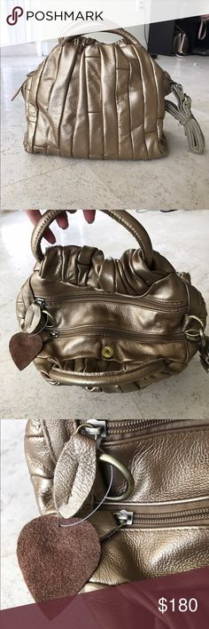 NWOT golden bag GENUINE LEATHER Brand new bag ! Never used ! Received as a gift , but it is not my style . Genuine leather.  Medium size . NOT Kate Spade just for exposure, kate spade Bags Satchels