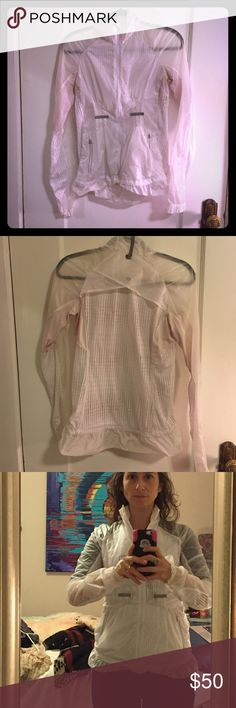Lululemon see through jacket Mesh and see through white running Lululemon jacket.  No size on the jacket but I assume it's a a or extra small.  Slight pink did coloring in the underside of the arms.  Very flattering and breathable. lululemon athletica Jackets & Coats