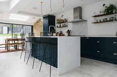 A London Victorian terrace with side return extension, mid-century style furniture and modern accents