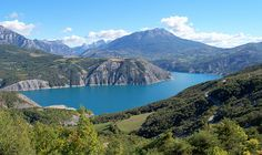 The artificial lake of Serre-Ponçon, surrounded by beautiful mountains in the summer #France