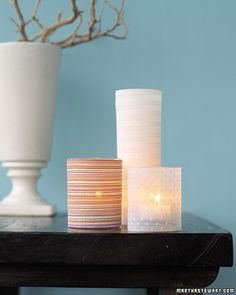 Candle Slipcovers    Turn glass candleholders into stylish accessories by dressing them in decorative fabric.