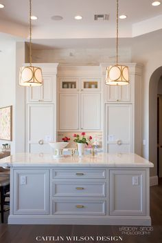 pretty kitchen- like the gold hardware and the cabinets. not the visible outlets though