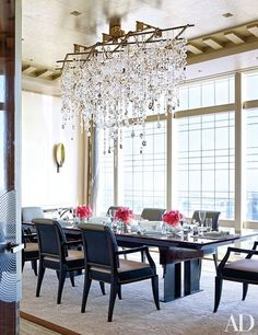 A handblown-glass-and-bronze chandelier designed by Randy Kemper and created by Megna Glass hangs above the dining room's 1960s French table.