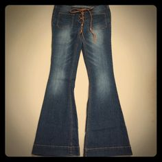 Tinseltown denim women size 7/8 flair jeans Tinseltown denim women size 7/8 flair jeans. So cute barely worn braided leather strap with beads Tinseltown denim couture Jeans Flare & Wide Leg