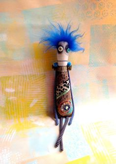 Handcrafted Anxiety Faerie art doll with button eyes and embroidered and painted details.