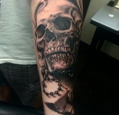 Black and Gray Skull Tattoos by Pete Terranova